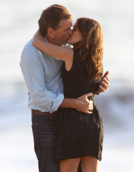 Salma Hayek and Pierce Brosnan got romantic once again for How to Make Love Like an Englishman, which they filmed on an LA beach on Tuesday.