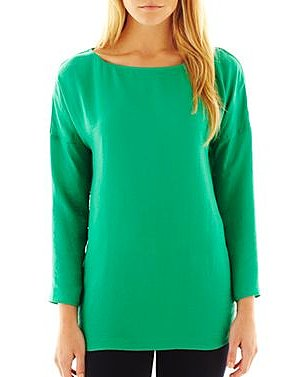 Don't be afraid to add a bold pop of color via this MNG by Mango volume-sleeve blouse ($25) in brilliant green.