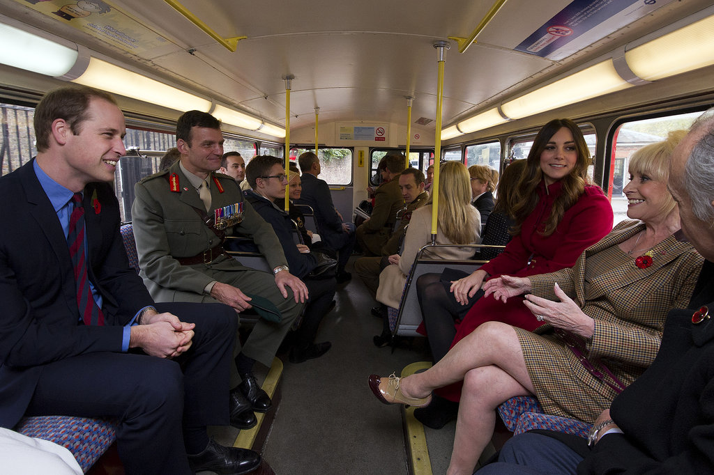 Kate Middleton and Prince William proudly wore red poppy pins as they met with poppy sellers at London subway stations and rode a public bus with several other VIPs on Poppy Day in England.