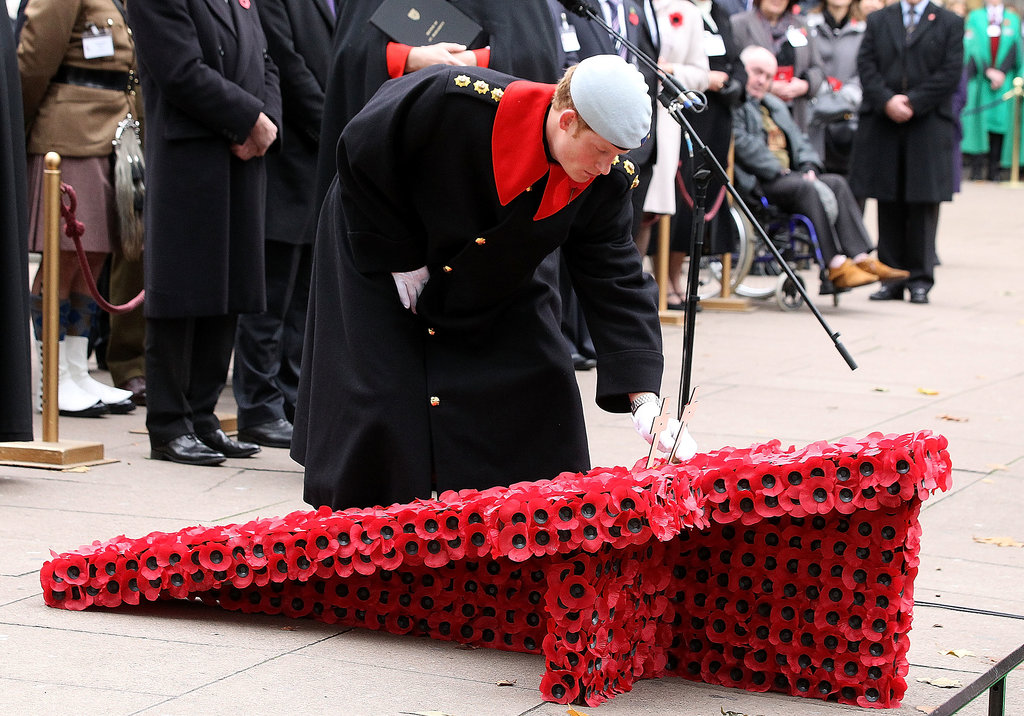 Prince Harry laid a poppy during his visit to Westminster Abbey.