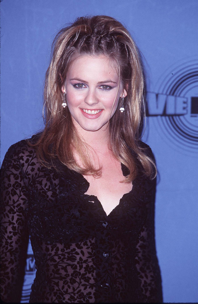 Between her fluorescent purple shadow and cornrowed half-updo, Alicia Silverstone epitomized the '90s at the 1997 MTV Movie Awards.