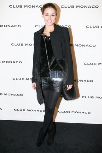 Olivia Palermo kept warm in a furry topper as she made her way to Club Monaco's New York party.