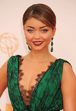A pair of chandelier earrings take center stage with a side-parted, slicked-back updo, like this one from Sarah Hyland.