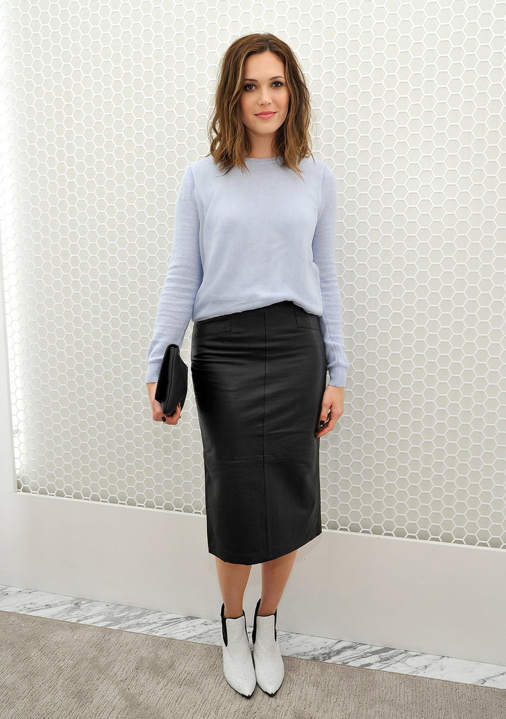 We love how Mandy Moore styled up her slouchy tee with a slick leather skirt and booties at the Topshop holiday party.