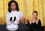 Blake Lively smiled while First Lady Michelle Obama spoke during the workshop.