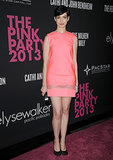 Hostess Anne Hathaway sported a melon pink shift with a sheer band for Elyse Walker's Pink Party in October 2013.