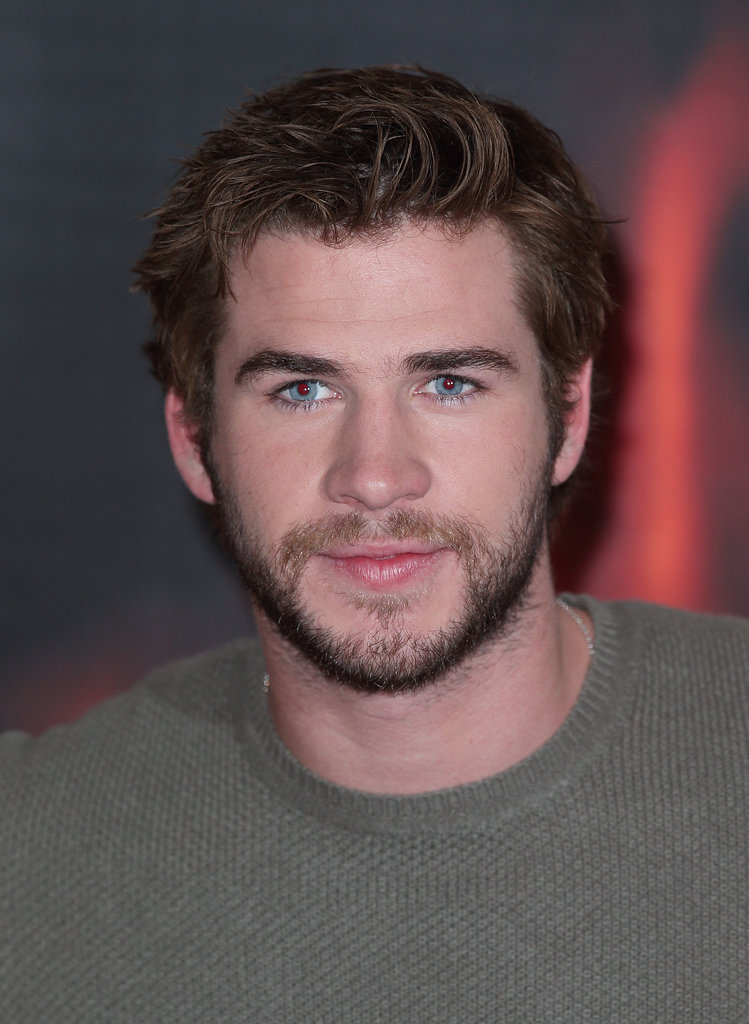 Liam Hemsworth wore a green sweater.