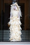 Just in time for Halloween, Lady Gaga channeled a ghost in a tattered white dress while leaving her hotel in London.