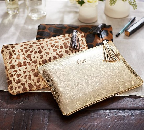 Amp up her makeup bag game with this Gold Leather Travel Pouch ($39, $7 per monogram).