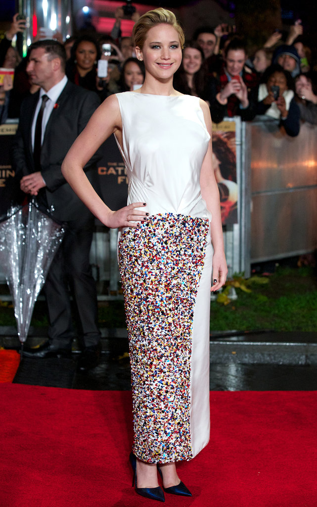 Jennifer Lawrence glowed in a white Dior Haute Couture sequined gown and black Kurt Geiger pumps on the red carpet at the film's world premiere in London.