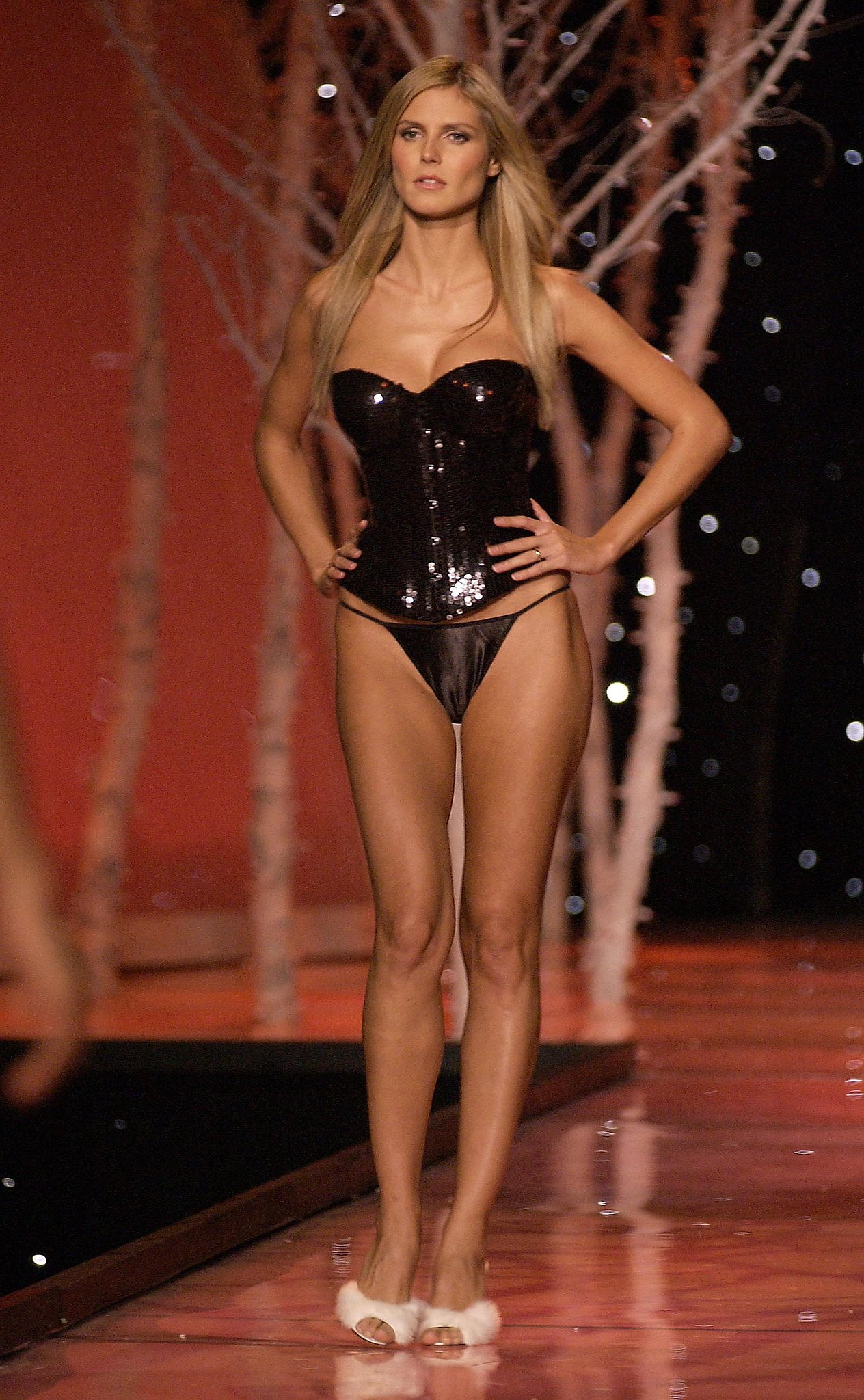 Heidi donned a black sequined corset in 2001.