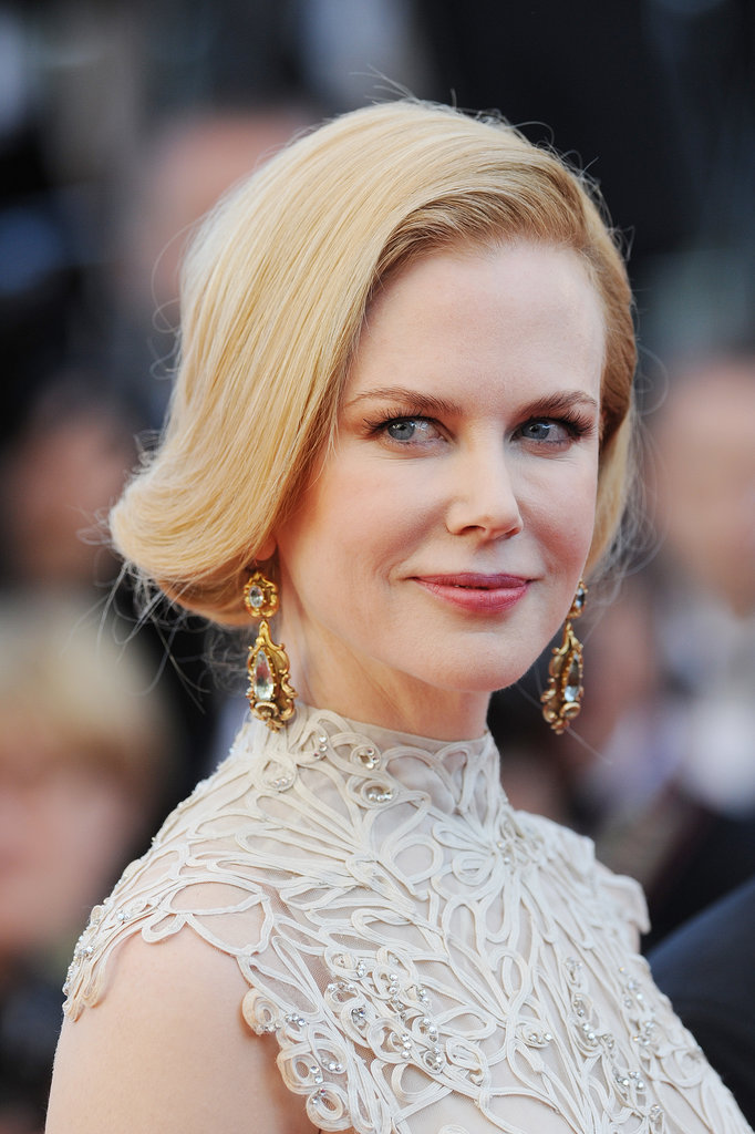 Nicole Kidman may have a bob now, but when she tried this fake short cut in Cannes, her hair fell past her shoulders. If you have a cowlick at the front, this look is perfect for you as it works with it. The hair sweeps up and over to one side, disappearing underneath itself at the neck.