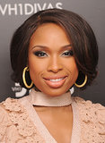 Due to the thickness of it, Jennifer Hudson's long hair takes on a very round shape when it's pinned up and under. To offset this, her stylist made sure to curl the front layers outwards. This is a great trick if you have thick hair.