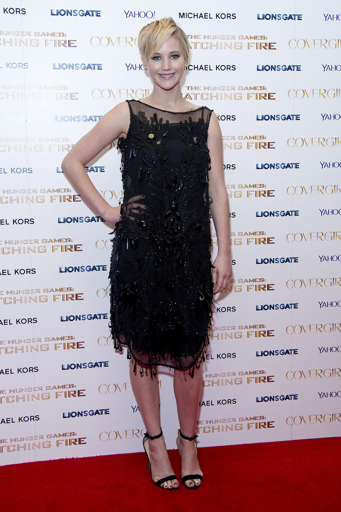 Jennifer Lawrence slipped into a sequined black Louis Vuitton dress for the Catching Fire afterparty in London.