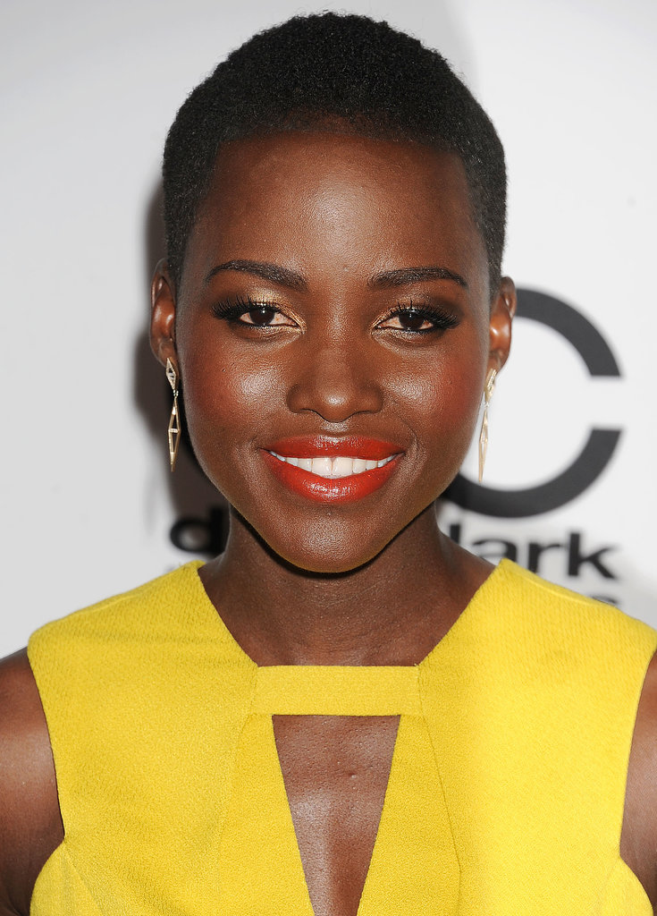 Who she is: Lupita Nyong'o How you know her: She stars in the critically acclaimed 12 Years a Slave.  Why we love her: We've never seen Lupita mess up on the red carpet, but you should expect guts like that from a girl who confidently rocks a shaved hairstyle.
