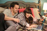 "New Girl Nick (Jake Johnson) and Jess (Zooey Deschanel) on New Girl's Thanksgiving episode, ""Thanksgiving III."""