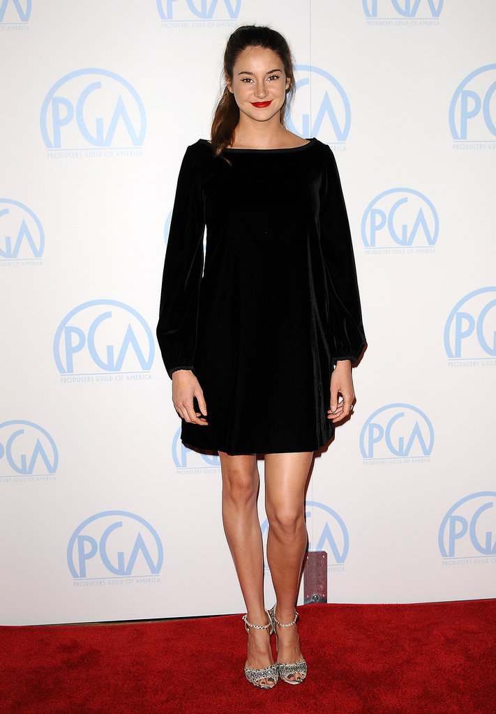 Black velvet in that little girl's (vibrant) smile. The actress went back to basics in a supple Valentino minidress, sparkling sandals, and a punchy red lipstick in 2012.