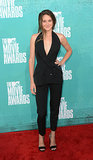 Shailene showed off her enviable curves — who knew she was hiding those bad boys?! — in a low-cut halter vest, featuring a sweet peplum-esque trim, slick black trousers, and dainty ankle-strap sandals, all by Stella McCartney, at the 2012 MTV Movie Awards.