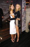 Karlie Kloss, in her Cushnie et Ochs number, was spotted hugging Toni Garrn, who showed off her dress's barely there side panels.