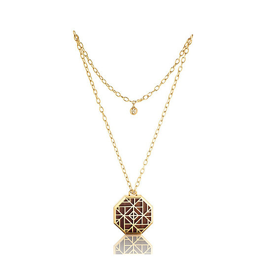 The Tory Burch Solid Perfume Pendant Necklace ($150) is the perfect marriage of beauty and fashion. The design mimics Burch's classic print, and within is her fragrance, which just launched this Fall.