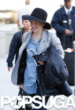 Rachel beamed as she departed LAX in March 2011.