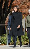 While commemorating Veterans Day at Arlington National Cemetery, she kept warm and chic in Burberry's tailored topper.