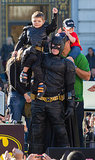 Batman held Batkid on his shoulders after the little one received a key to the city.