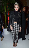 Channeling her inner '90s grunge girl in a cropped high-collar top, studded leather jacket, and plaid leggings for a party honoring Mario Testino in February of this year.