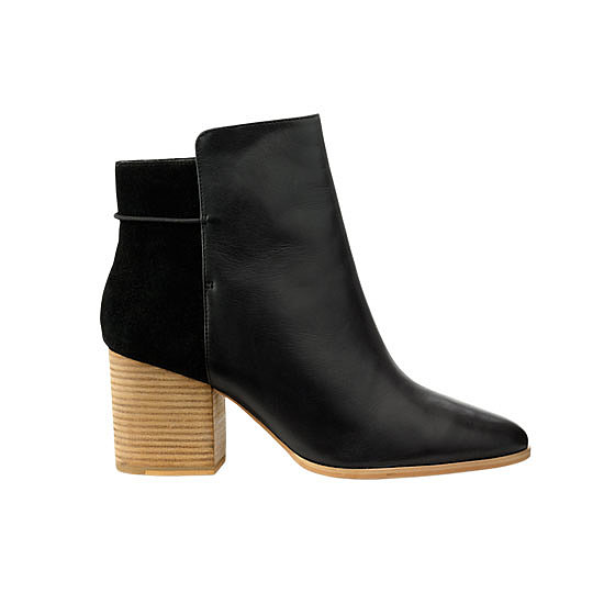 A pair of heeled booties, like Kate Spade Saturday mixed media ankle boots ($150) can take you from day to night. Wear them while you travel to free up room in your bag.