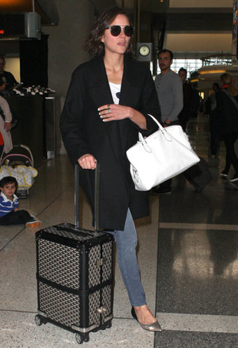 Marion Cotillard knows how to roll in style — literally. We love her luxe trolley, which coordinated with her black cardigan and white bag perfectly.