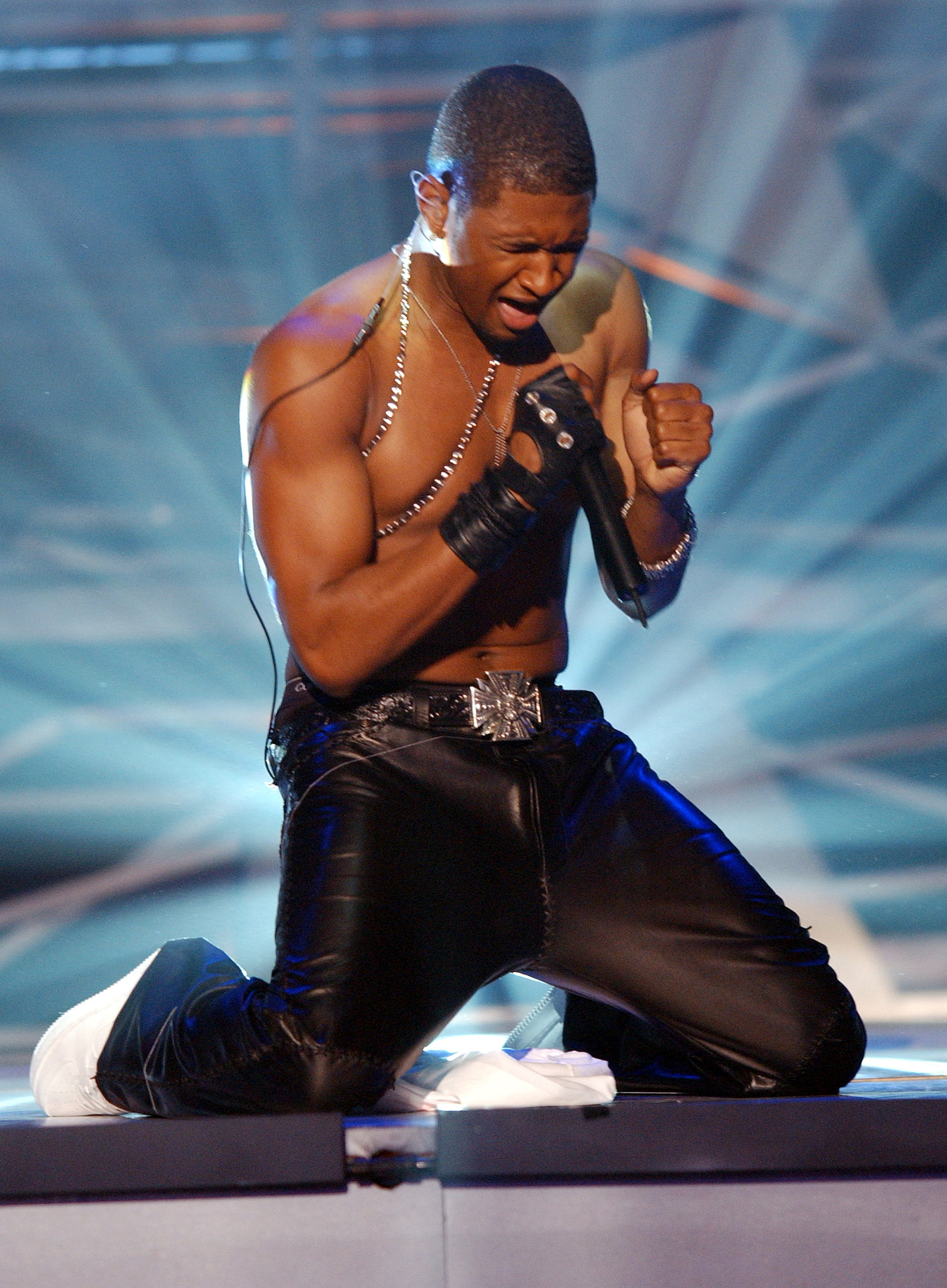 Usher performed shirtless in 2002.
