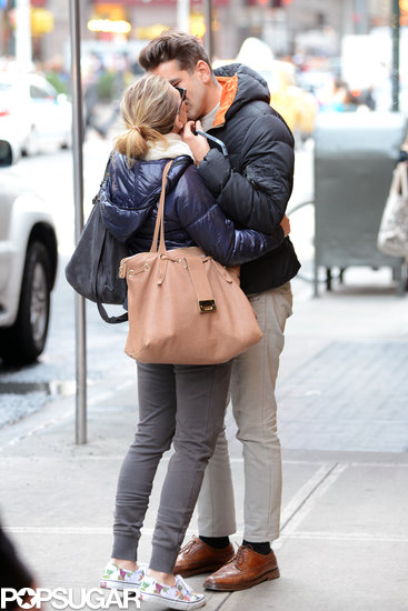 Scarlett Johansson embraced her then-boyfriend, Romain Dauriac, outside of their NYC hotel in December 2012, less than a year before their engagement.