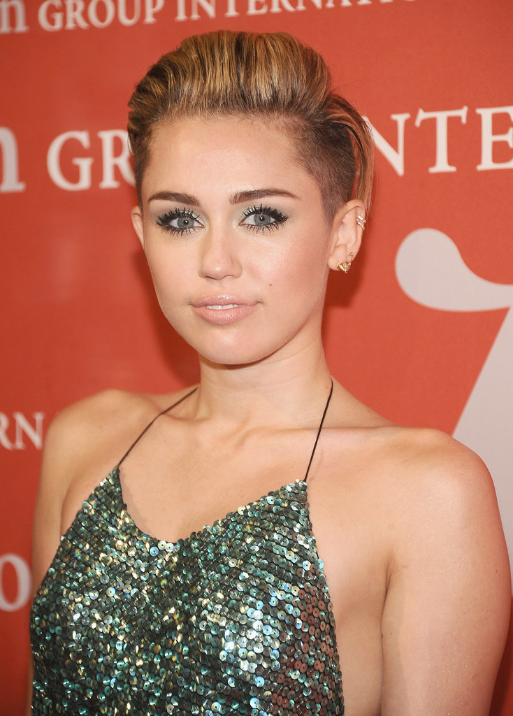 Miley toned her beauty look down at the 30th annual Night of Stars event wearing a seafoam eye shadow and sequined dress, transforming her shaved sides into a very ladylike look indeed.