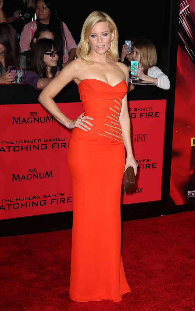 The linear gold detailing on Elizabeth Banks's strapless Versace gown at the Catching Fire LA premiere reminded us of fire — a fitting reference for her film's title and when we're dreaming about the holidays.