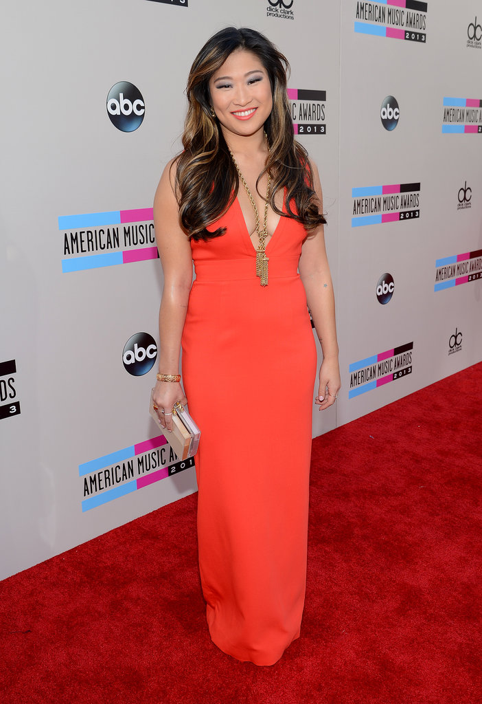 Jenna Ushkowitz upped the wow factor with a plunging orange gown, caramel-infused waves, and decadent gold accessories.