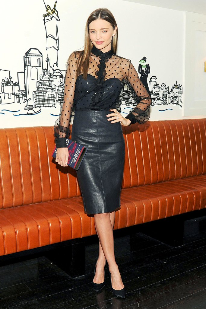 We love Miranda Kerr's approach to party wear — a leather skirt gives the outfit some edge.