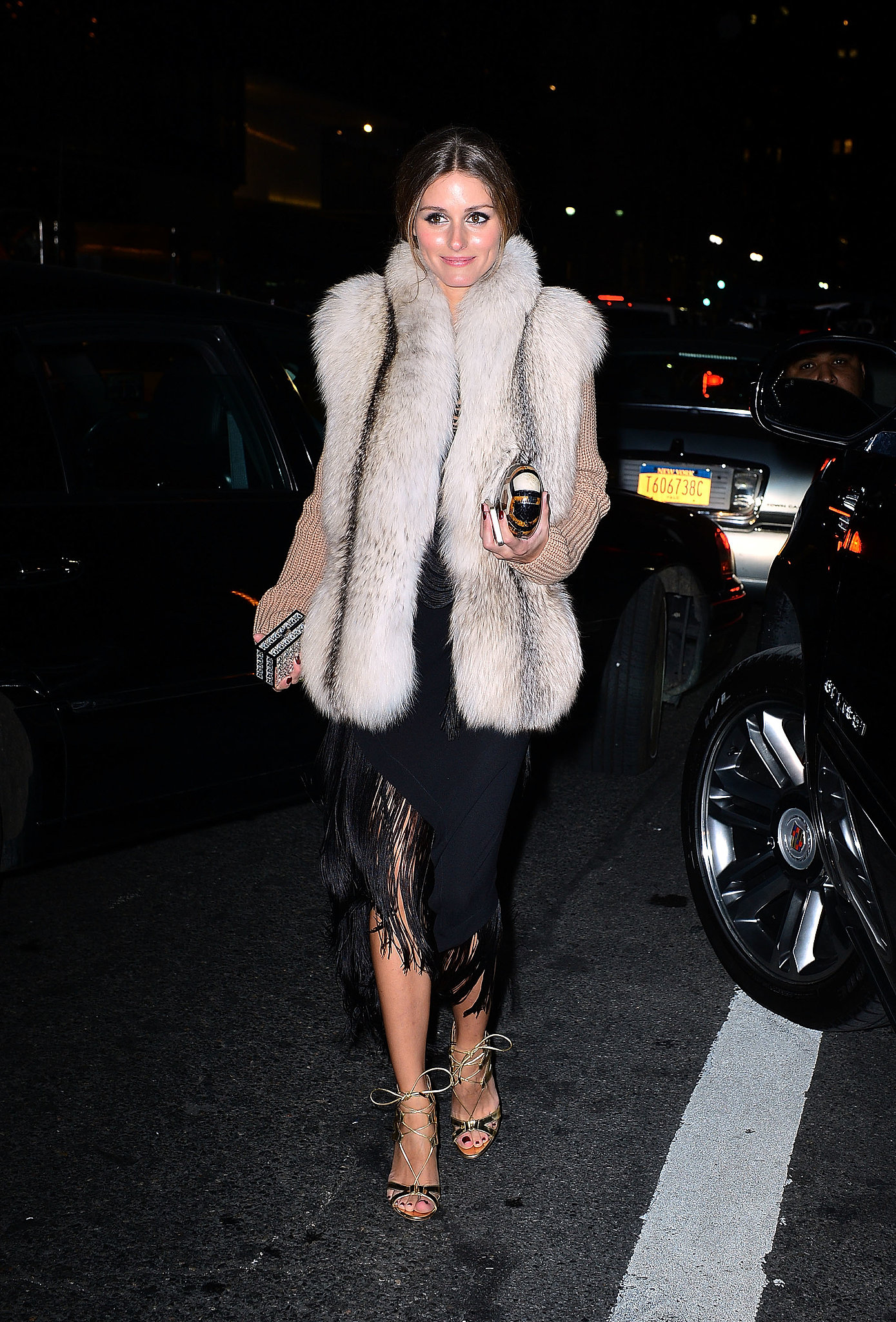 Olivia added a furry vest to her evening look for a chic Winter-ready effect.