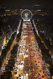 The Champs-Élysées in Paris was lit up with lights.