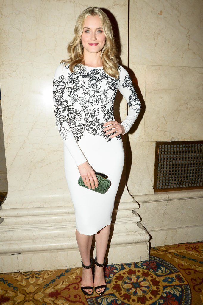 We love Taylor Schilling's chic white sheath as an alternative to the usual holiday dresses.