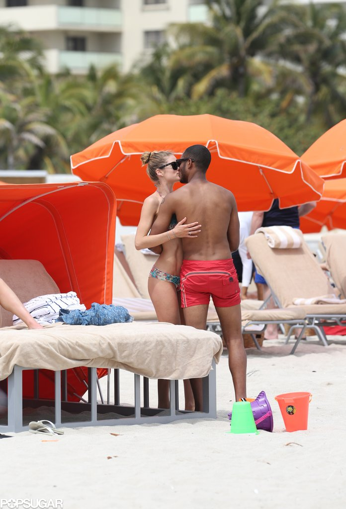 In March, Doutzen Kroes gave husband Sunnery James a smooch when they hit the beach in Miami.