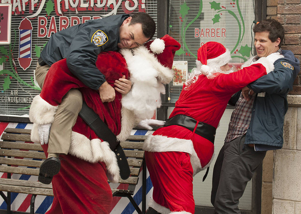 Brooklyn Nine-Nine Jake and Boyle (Joe Lo Truglio) get into a scuffle with some Santas.