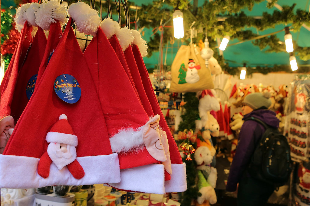 Santa hats were hung at the Frankfurt, Germany, Christmas market.