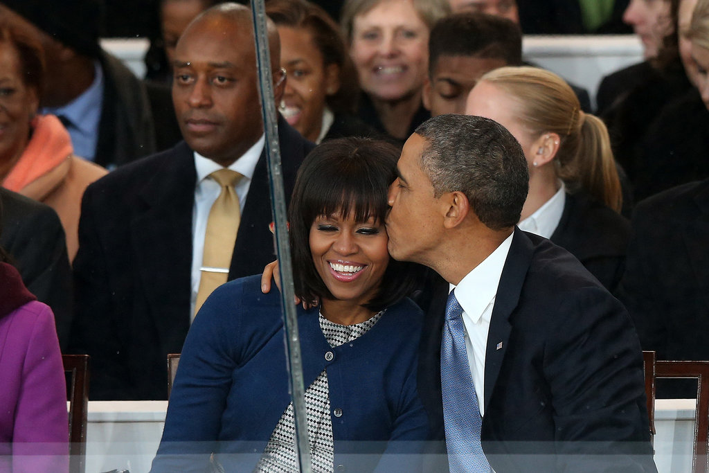 President Obama planted a kiss on Michelle's cheek during the parade on Inauguration Day.