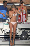 Kate Moss wore a bikini when she jumped off a boat during an August trip to Formentera.