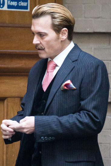 Johnny Depp showed off his handlebar mustache on the set of Mortdecai in London on Tuesday.