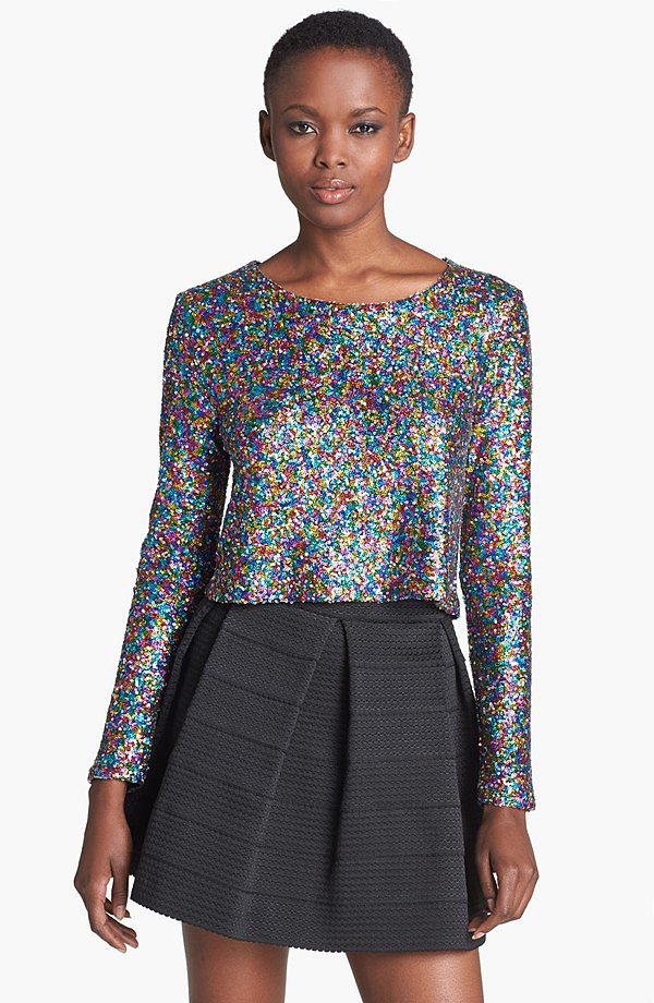 "Opt to dress this MinkPink Glamour Glitter Sequin Top ($89) up with sleek black pants, or just throw on your jeans — either way, the look says, ""I'm ready to party."""