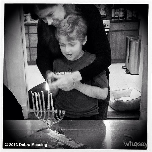 Roman Zelman lit the menorah for Hanukkah with his mom, Debra Messing. Source: Instagram user therealdebramessing