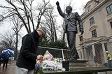 A man in Washington DC stopped by the Nelson Mandela statue.