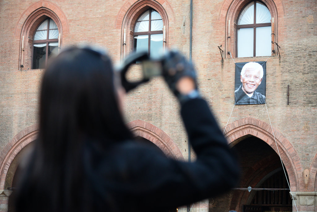 A woman snapped a photo of Nelson Mandela's photo in the Palazzo D'Accursio in Bologna, Italy.