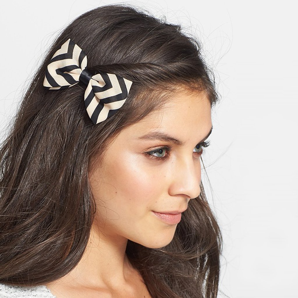 Every outfit needs a finishing touch — like this supergirlie hair bow ($6) from Capelli of New York.
